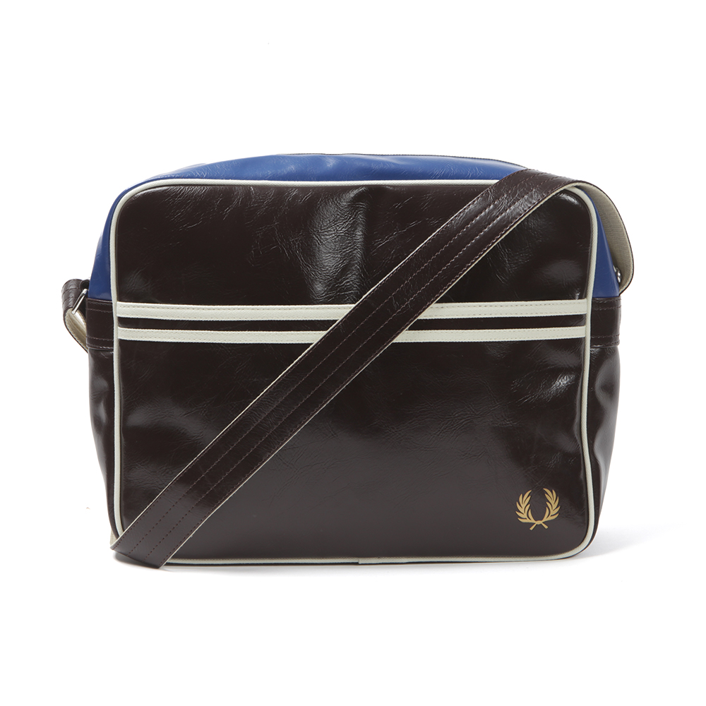 Fred Perry Classic Shoulder Bag, In Chocolate. With Shoulder Strap And Contrast Trim. Zip Main Compartment And Front Pocket. Fred Perry Printed Wreath Logo On The Front Of The Bag.A Perfect Way To Carry Your Everday Items In Style.