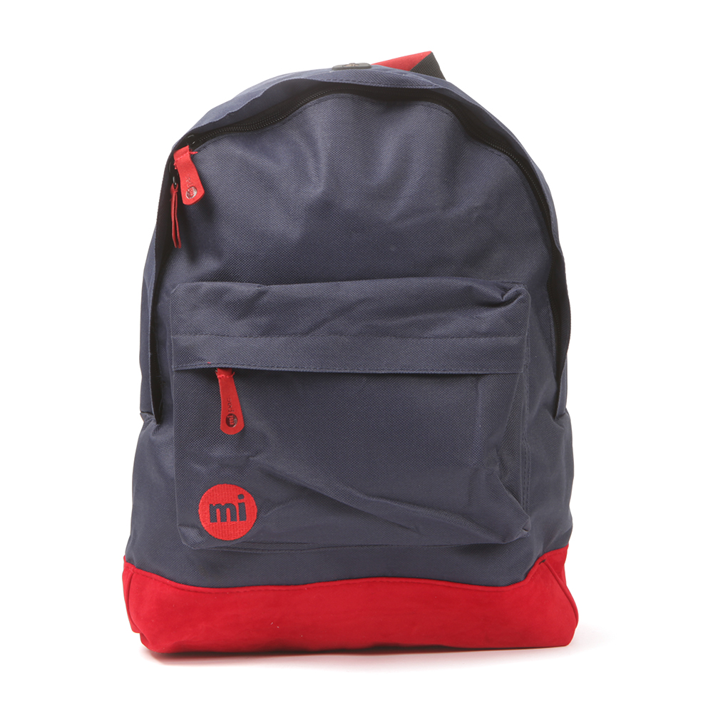 Mi Pac Classic Back Pack, in navy & red.A tough durable, water resistant polyester backpack that has faux suede base. Adjustable padded shoulders, zip front pocket and zip fastening to the main compartment. Completed with the Mi Pac logo embroidered to the front to finish this everyday bag.