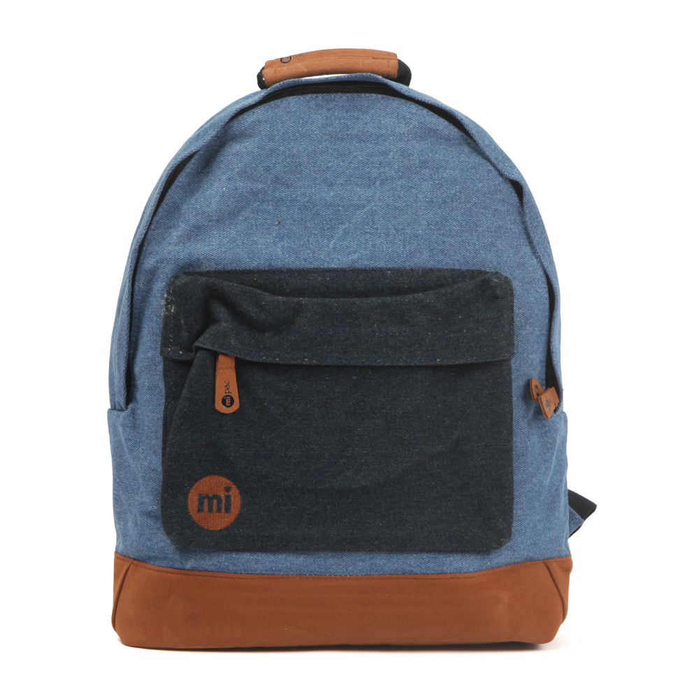 Mi Pac Denim Pocket Backpack, in Stone Wash.A tough durable, water resistant polyester backpack that has faux suede base. Adjustable padded shoulders, zip front pocket and zip fastening to the main compartment. Completed with the Mi Pac logo embroidered to the front to finish this everyday bag.