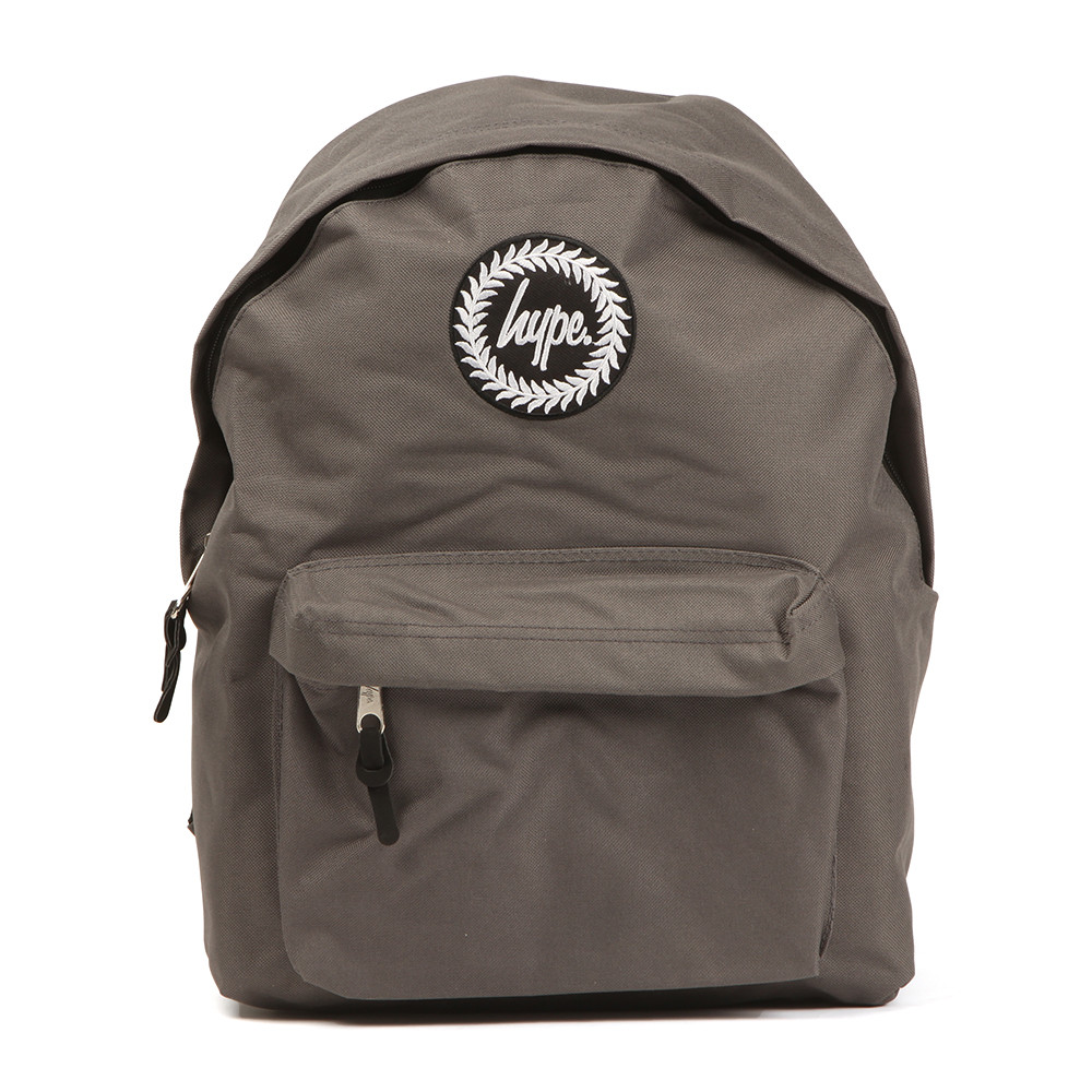 Hype Classic Backpack, in Charcoal.A unique practical backpack that can be used for all occasions. With a zip entry to the main compartment, zip front pocket, adjustable shoulder straps and finished with the Hype branding to the front.