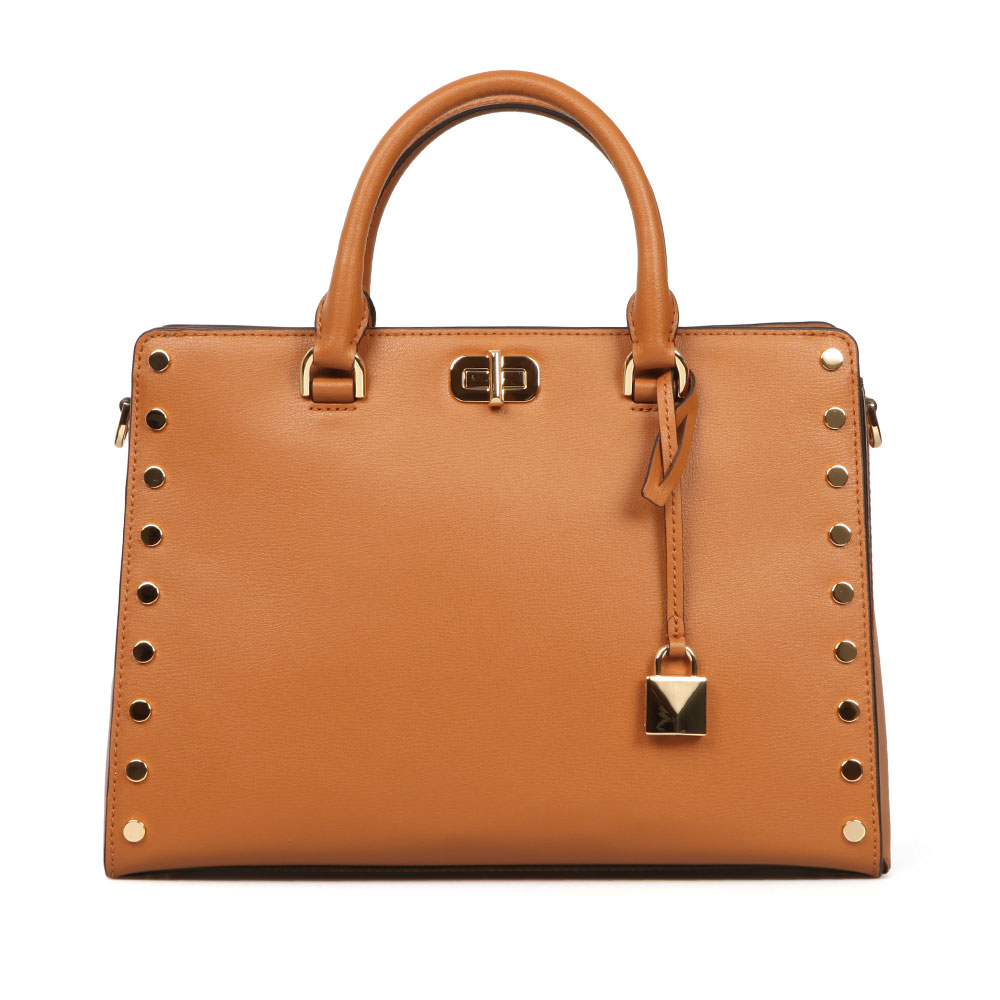 Michael Kors Sylvie Stud Large Satchel in 'acorn' is a tan leather bag that features metallic gold stud detailing to the front and back, short twin handles and a long, detachable shoulder strap for more casual use. A metal clasp fastener to the front secures a slip pocket and a branded padlock charm adds to the 'luggage' theme. Approx: H: 23cm x W: 31cm x D: 14cm
