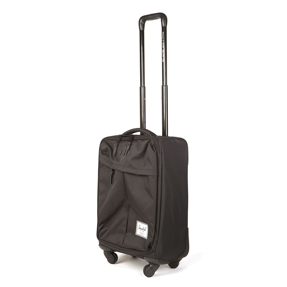 Herschel Highland Trolley Case, in Black. The two wheel campaign luggage silhoutte is perfect for short trips. Complementing its clean design are functional external storage options and mesh partitioned main compartent.