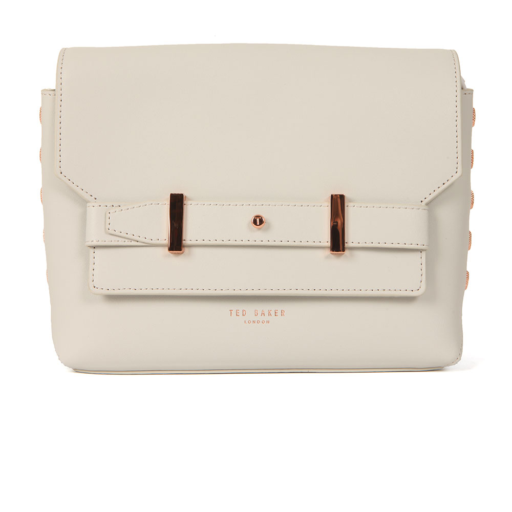 Ted Baker Tursi Studded Edge Cross Body Bag in 'light grey' is a small leather bag that has been updated with rose gold hardware to the front and sides. The grey bag has a long shoulder strap and finished with Ted Baker branding in a rose gold print. Approx: W: 23cm x H: 16.5cm x D: 7cm