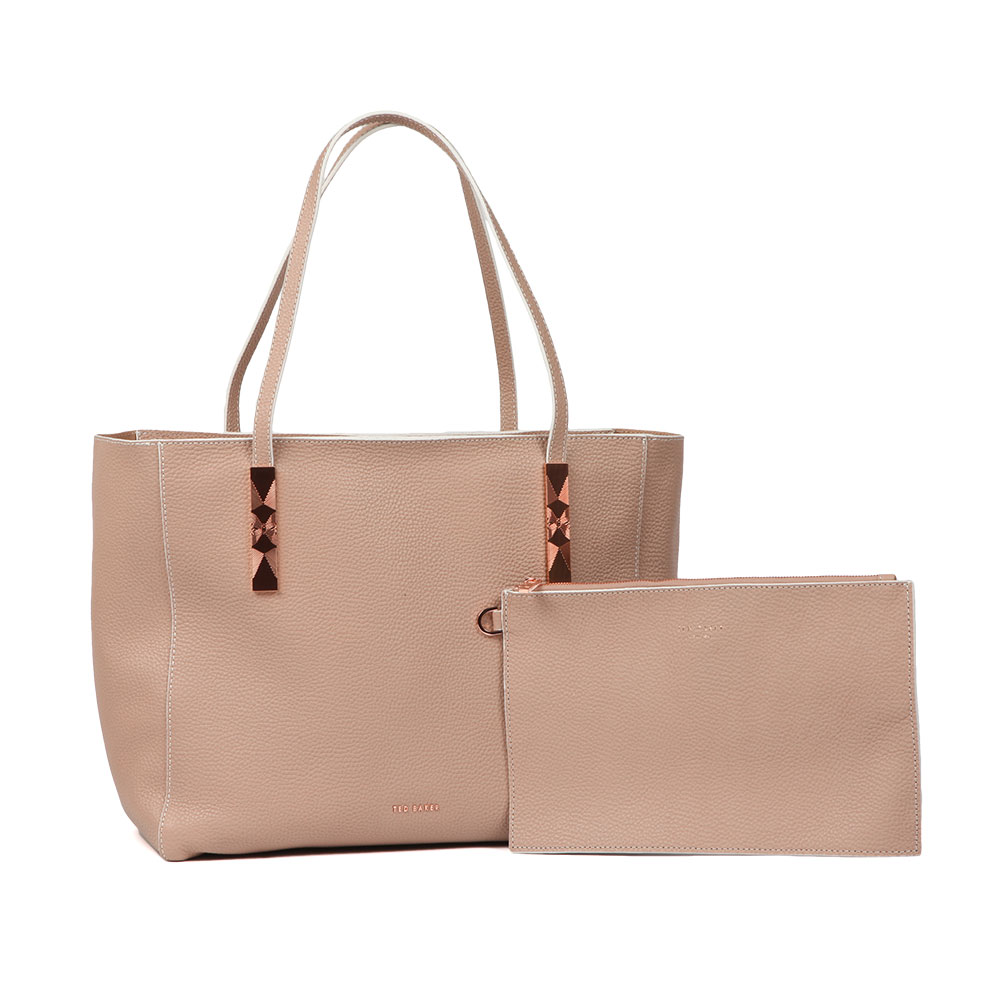 Ted Baker Paigie Soft Grain Large Zip Tote Bag in 'mink' is a nude pink leather bag that has an all over texture, striking rose gold detail and a top zip fastener to ensure all essentials are stored safely. Small and simple raised Ted Baker lettering is all that is needed for the front of the bag to keep the look classic and sophisticated. A matching nude clutch bag is also included and features a detachable wrist strap. Approx: H: 26cm x W: 41cm x D: 15cm Clutch Approx: H: 17cm x W: 2
