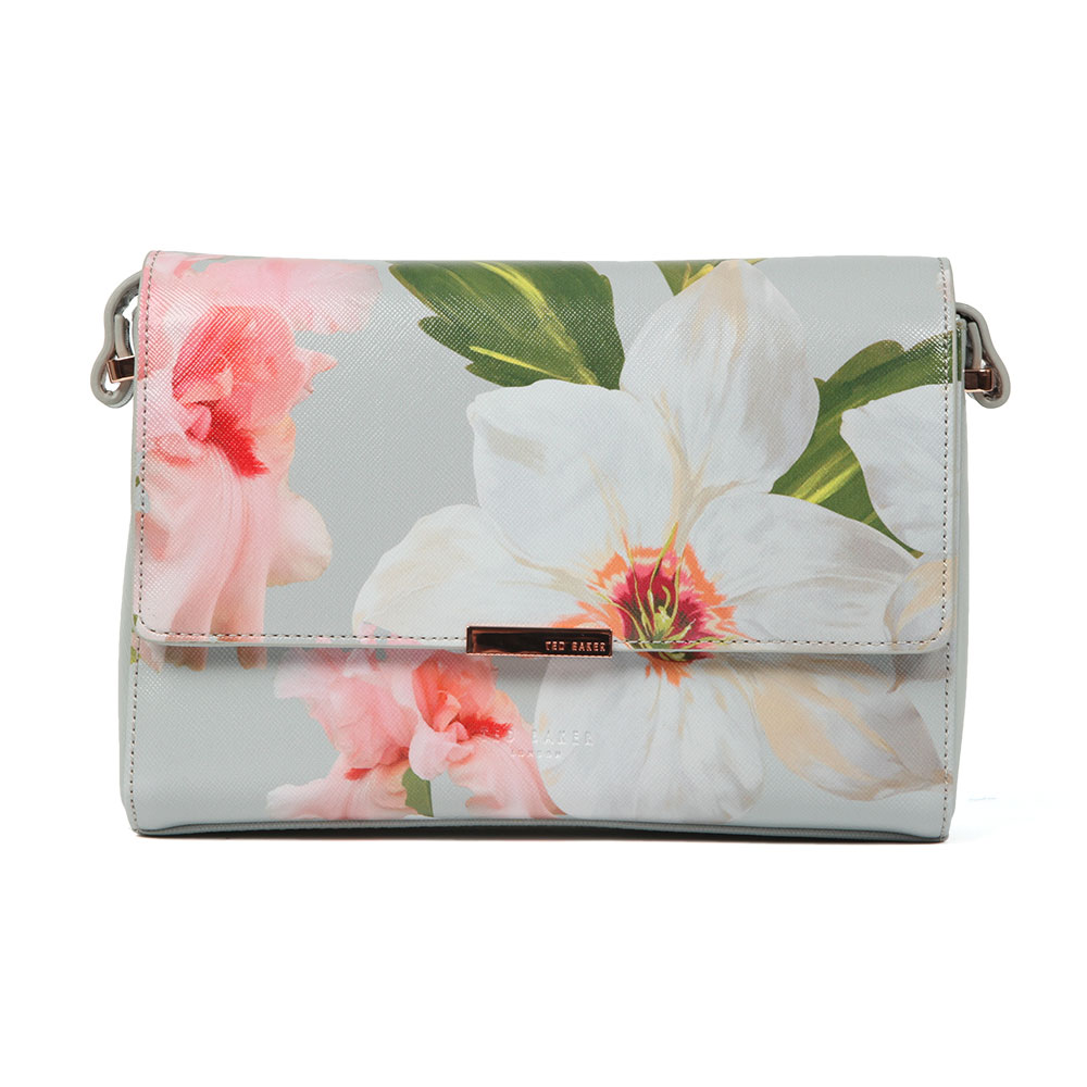 Ted Baker Prim Chatsworth Bloom Xbody Bag in 'mid grey' has been crafted with an all-over grainy texture in a pretty floral print design. Rose gold branded hardware is displayed to the front and the shoulder strap can be adjusted accordingly. Team with an all black outfit for an eye-catching look. Approx: H: 16cm x W: 23.5cm x D: 6.5cm