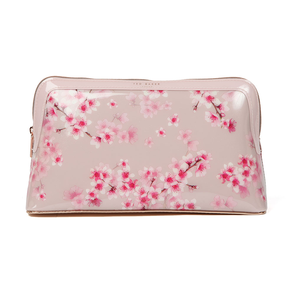 Pink Blossom Ted Baker Washbag in 'light pink' is a new addition to Ted's signature patent bag collection and features an all-over pink oriental blossom design and rose gold Ted Baker branding. Use the versatile bag to store toiletries or makeup. Approx: H: 15cm x W: 27cm x D: 8cm