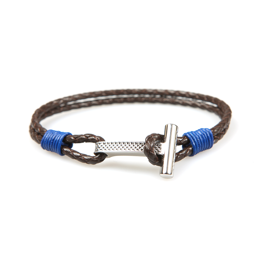 The Ted Baker Knurling Bracelet in Brown, a small, tight weave leather bracelet with a metal T shaped hook closure.