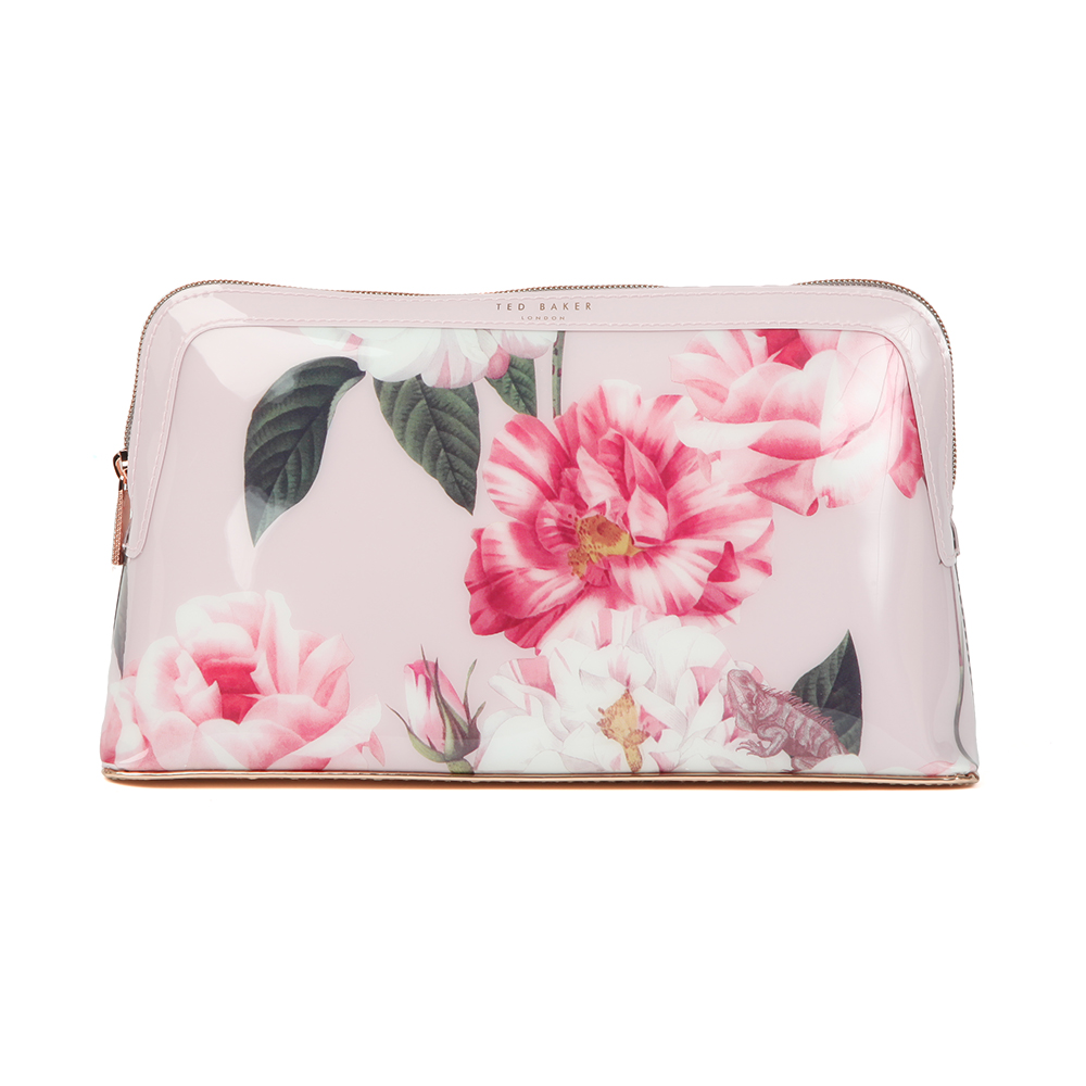 Ted Baker Amana Iguazu Washbag in 'light pink' displays Ted's latest floral print design and coated in the signature gloss finish. Store toiletries or makeup essentials. Approx: H: 16cm x W: 27cm x D: 8cm